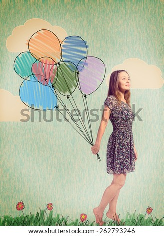 imagination. young woman is standing with drawn balloons - stock photo