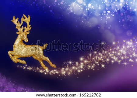 Imaginative Christmas composition with flying golden reindeer in a magical fantasy night sky - stock photo