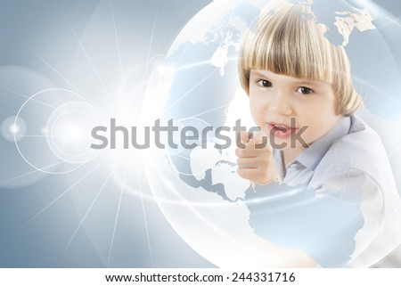 Imaginative, curious young boy pointing his finger at a globe, looking for  holiday destination round the beautiful world, planning adventure. - stock photo