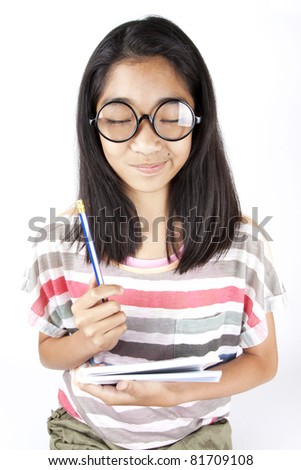 Imagine, Asian girl close eyes thinking something in her head - stock photo
