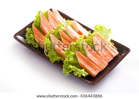 imitation crab meat on white, japanese food - stock photo