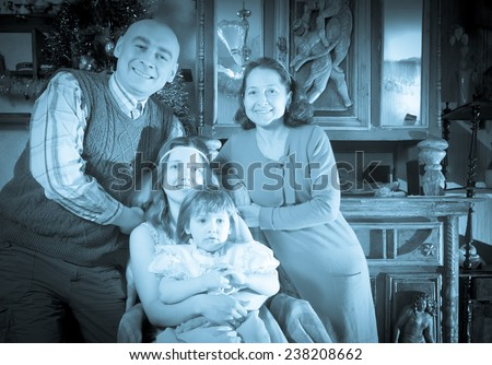Imitation of antique portrait of happy family with Christmas tree at home  - stock photo