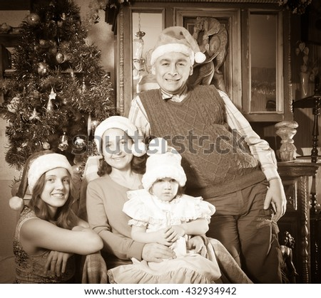 Imitation of  Vintage photo of  married couple with child visiting mom for Christmas - stock photo