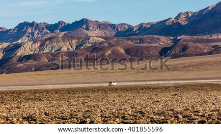 Immense area of rock salt eroded by wind and rain into jagged spires. The floor of Death Valley is covered by a huge salt pan. Devil's Golf Course, Death Valley National Park - stock photo