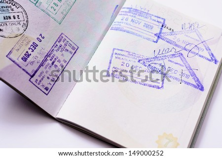 Immigration arrival stamps on passport - stock photo
