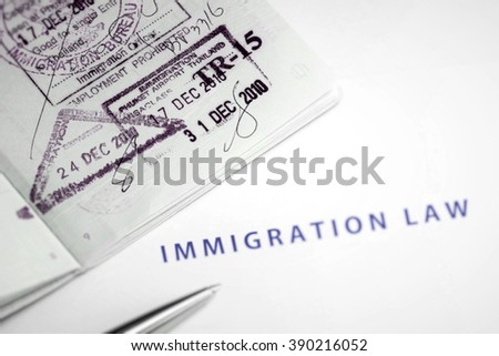 Immigration law document and arrival stamps on passport  - stock photo