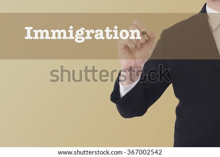 Immigration word on vintage background retro virtual screen touch by business man. - stock photo