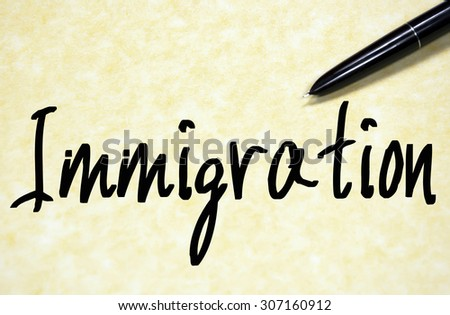 immigration word text write on paper  - stock photo