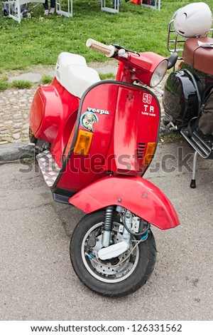 """IMOLA (BO) ITALY - APRIL 29: italian scooter tuning; vintage Vespa modified with disc brake at motorcycle rally """"III Vespa in fiore"""" on April 29, 2012 in Imola (BO) Italy - stock photo"""