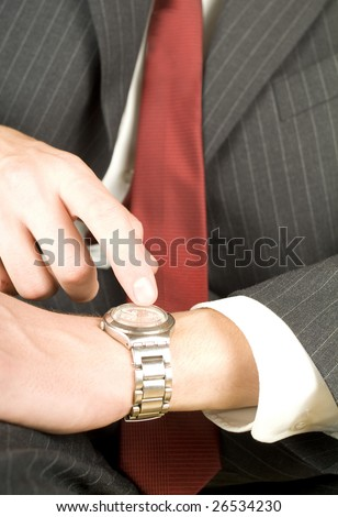 impatient business man pointing at his watch