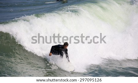 IMPERIAL BEACH, CALIFORNIA - June 3, 2015: People surfing at Imperial Beach California. Imperial Beach is the southernmost beach city in Southern California and the West Coast of the United States