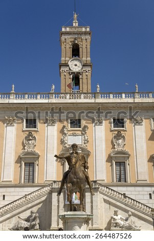Imperial Roman Equestrian Statue of Marcus Aurelius in front of the Senatorio Palace in the Piazza del Campidoglio at the top of Capitoline Hill in Rome, Italy, Europe  - stock photo
