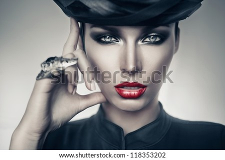 imperious woman in black with sexy red lips - stock photo