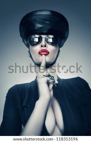 imperious woman in sunglasses - stock photo