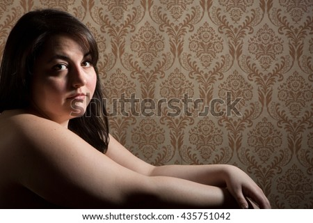 Implied topless BBW - Large frame - woman with brown hair posing in the studio