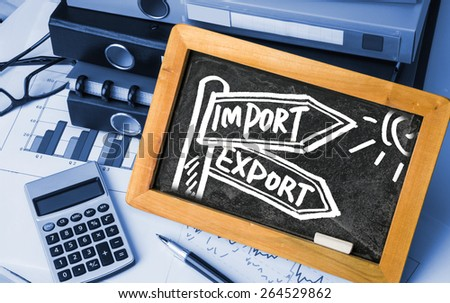 import and export concept signpost hand drawing on blackboard