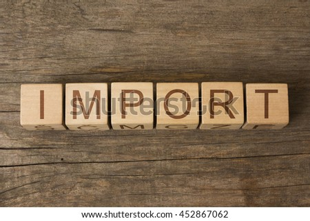 IMPORT word on wooden cubes - stock photo