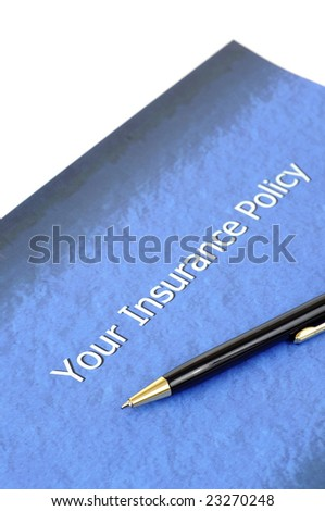 important Insurance policy document with a pen lying over it - stock photo