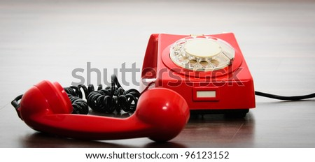 Important red phone on white background - stock photo
