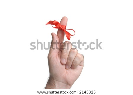 important remember ribbon tied on finger as reminder close up - stock photo