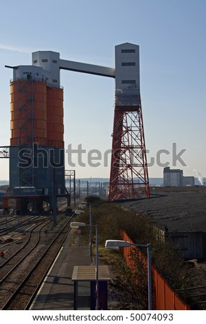 Imported coal track-side at Avonmouth ready for loading on to train wagons for distribution around the UK - stock photo