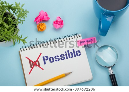 Impossible change transformed into Possible written on notebook page - stock photo