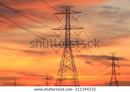 Impression network at transformer station in sunrise, high voltage up to full color sky take with sunset tone, horizontal frame