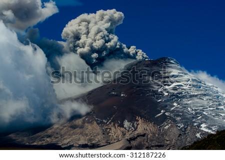 Impressive and beautiful active Cotopaxi volcano erupting in Ecuador, South America - stock photo