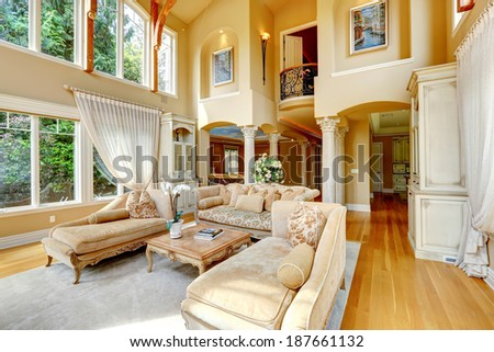 Impressive high ceiling living room antique furniture and columns - stock photo