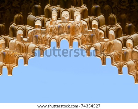 Impressive islamic decorations. Alhambra (Granada). Hanging elements in the form of stalactites are called muqarnas. - stock photo