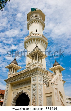 impressive mosque tower architecture with blue sky white clouds - stock photo