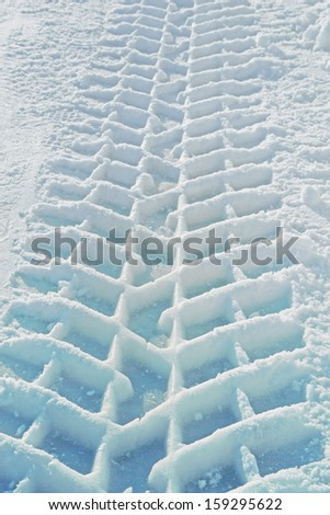imprint of a truck tire in snow - stock photo