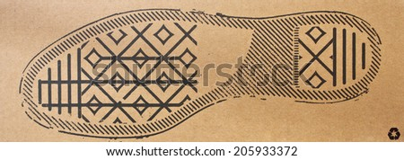 imprint soles shoes - sneakers on cardboard background - stock photo