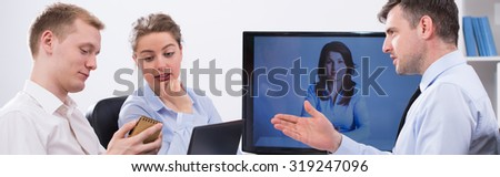 Impulsive business discussion during video conference with boss - stock photo