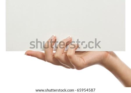 In a beautiful hand a paper blank leaf - stock photo