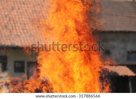 In a big flame burning building - stock photo