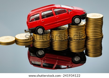 in a car you have rising costs through fuel, insurance, parking fees and tolls. - stock photo
