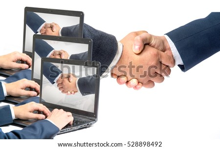 in a handshake office laptops, a number , a handshake on monitor