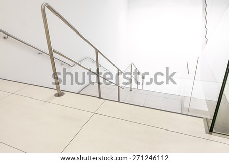 in a large building, there is a marble staircase