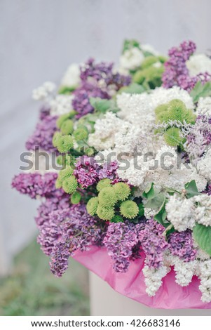 in a vase large bouquet of purple and white lilac - stock photo