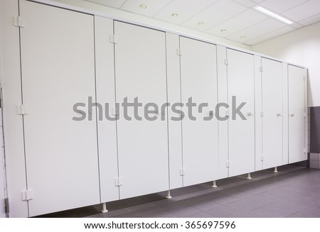 In an public building are womans toilets whit white doors - stock photo