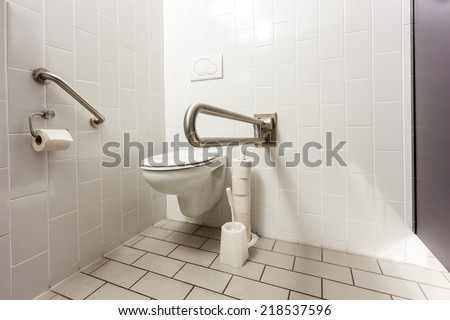 in an public toilet is there an disabled toilet - stock photo