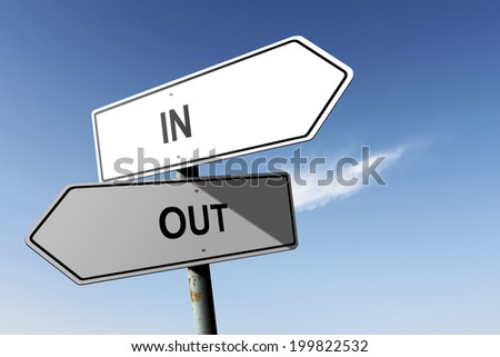 In and Out directions.  Opposite traffic sign. - stock photo