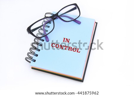 IN CONTROL word in notepad with white background - stock photo
