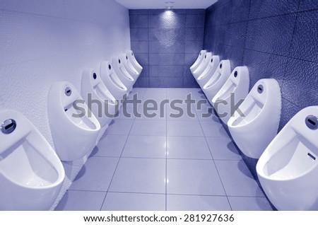 In door urinals men public toilet. - stock photo
