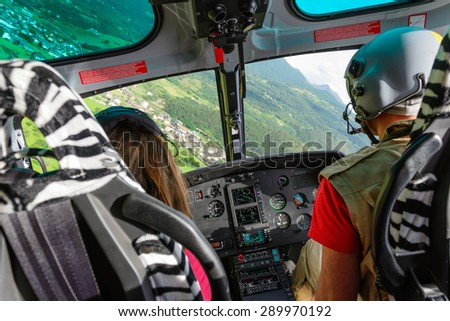 In flight of civil helicopter - stock photo