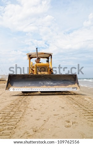 in front of the bulldozer on the beach - stock photo