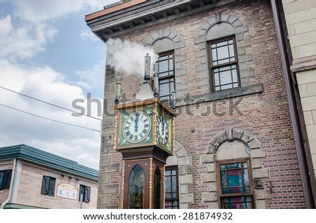 In front of the Otaru music box museum stands a steam clock, a present by the city of Vancouver. - stock photo