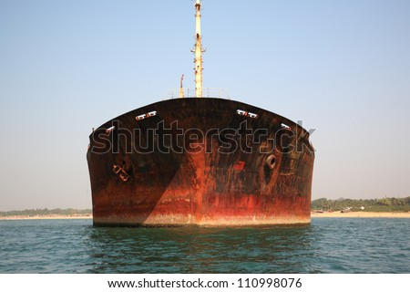 In front of the stranded River Princess Goa India - stock photo