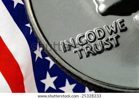 In God We Trust on 1967 United States Quarter over American Flag - stock photo